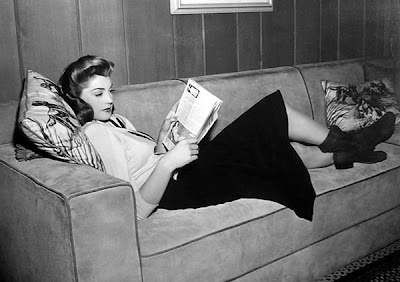 Esther Williams reads in boots.