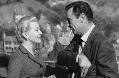 With Lana Turner, probably from Two Weeks in Another Town (1962). And he's smoking!