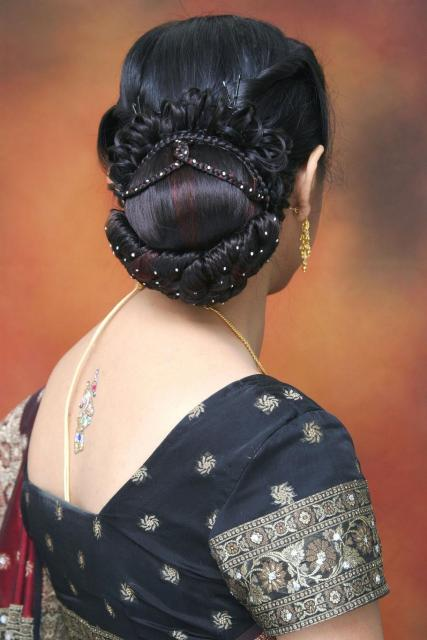 Low Bun Hairstyle for South Indian Wedding Dinner Reception