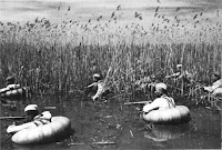 Soviet soldiers crossing the river