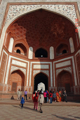 A glimpse of the Taj Mahal through the small outer gate
