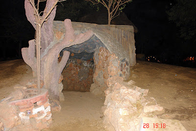 Chokhi Dhaani in Jaipur - The entrance to a cave inside the compound