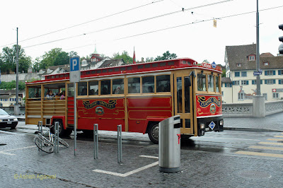 A tourist bus conducting tours of Zurich in Switzerland