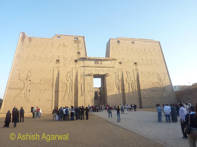 Edfu temple in Egypt - the first pylon along with tourists