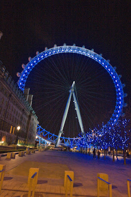 A view of London Eye at night from outside the entry point