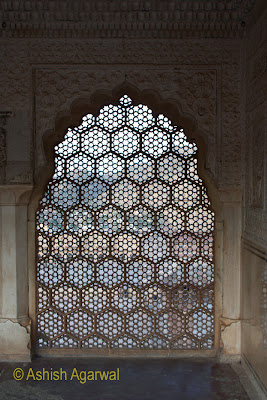 A windows lattice work inside the Amber Fort in Jaipur