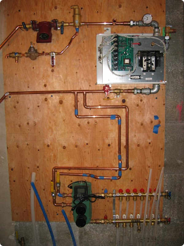 A green home day 124 shower completed cabinets and heating for Room heating systems