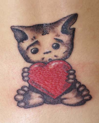 kitten with heart tattoo