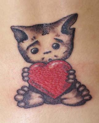 kitten with heart tattoo