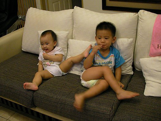 olivia & cousin ethan eating lollipop and watching tv together