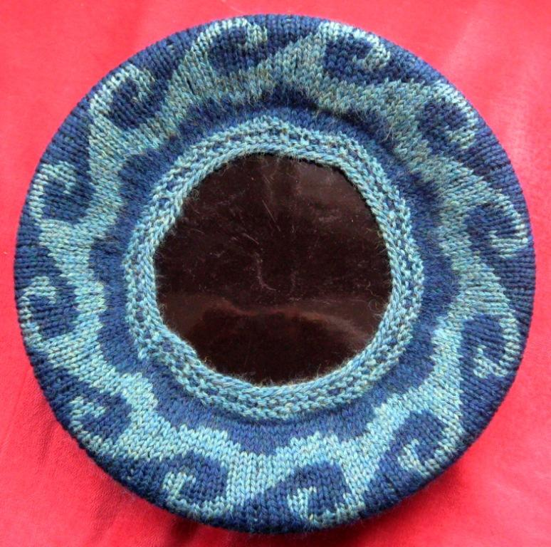 I took the photos of the beret while it was being blocked on a large plate.