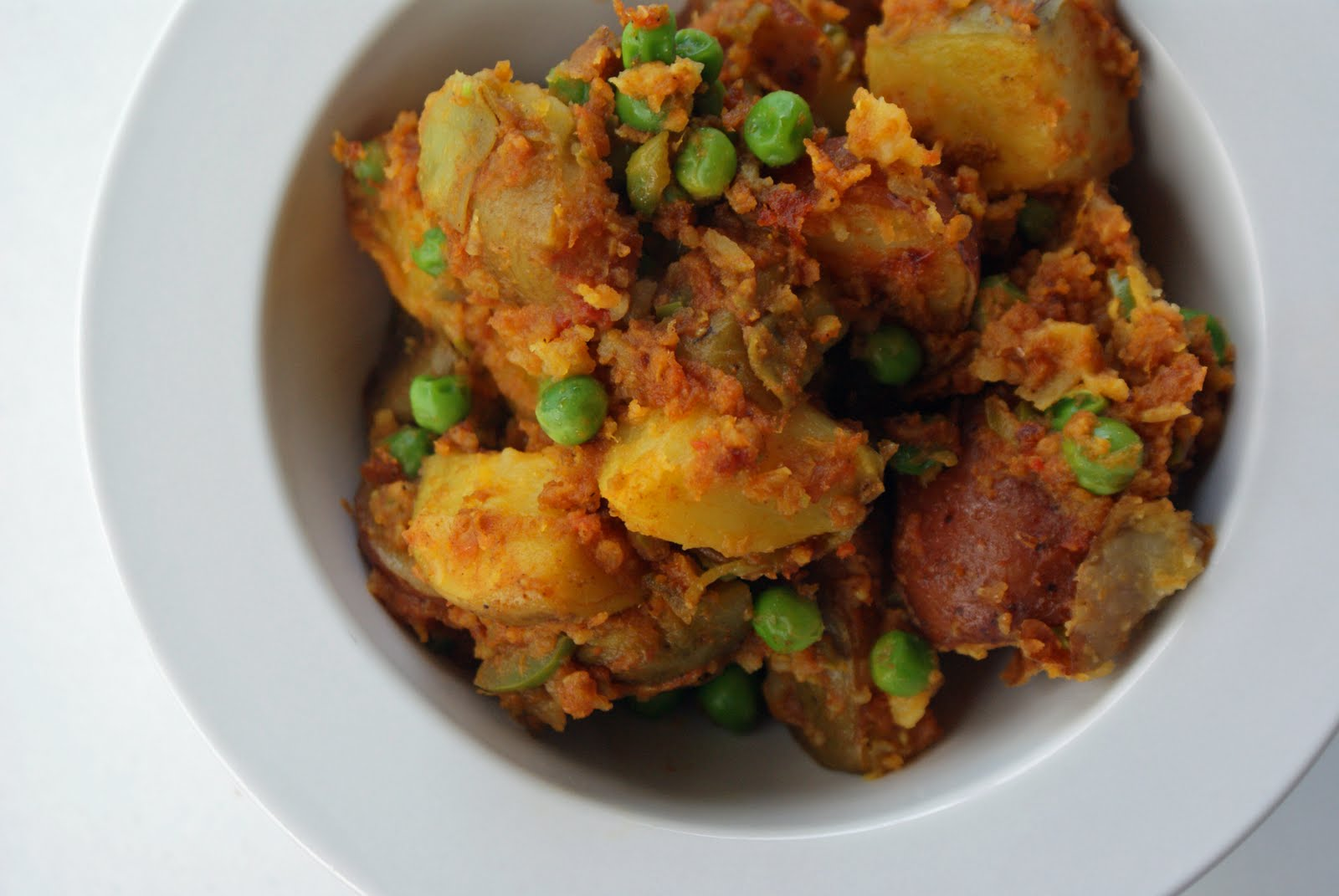Curried Potatoes with Crushed Tomatoes and Peas - Dinner With Julie ...