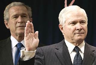 President Bush giving Defense Secretary Robert Gates the old rabbit ears at swearing-in ceremony