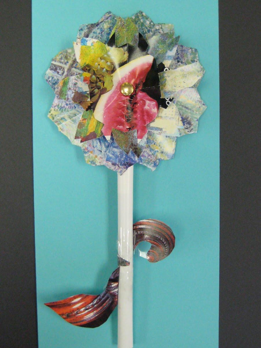 Recycled magazine flowers teachkidsart for Recycled flower art