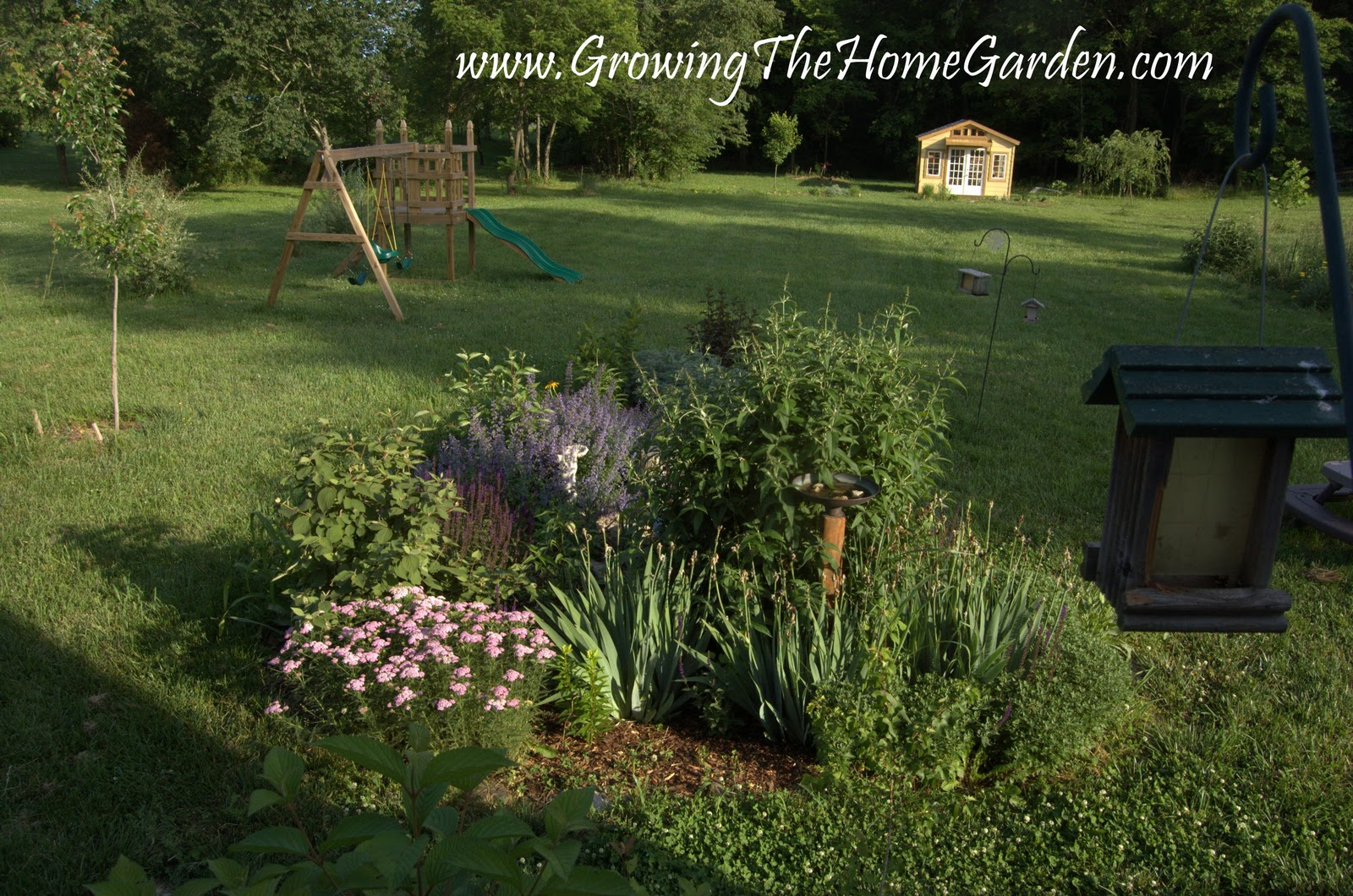 From This Perspective You Can See The Vegetable Garden And The Garden Shed.  In The Middle Is A Nice Little Kids Table The Girls Enjoy Playing With.