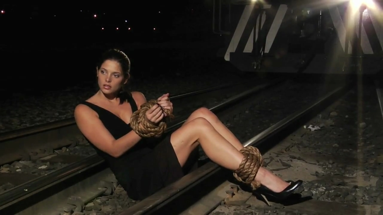 tied naked on the tracks