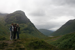 Moss covered peaks of Glencoe in the backgroud, family in the foreground