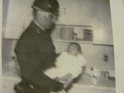 Steven E. Streight held by father William E. Streight as baby at Fort Knox, Kentucky army hospital