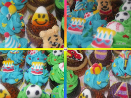 An assorted selection of cupcake flavors topped with a wide selection of edible sugar shapes.