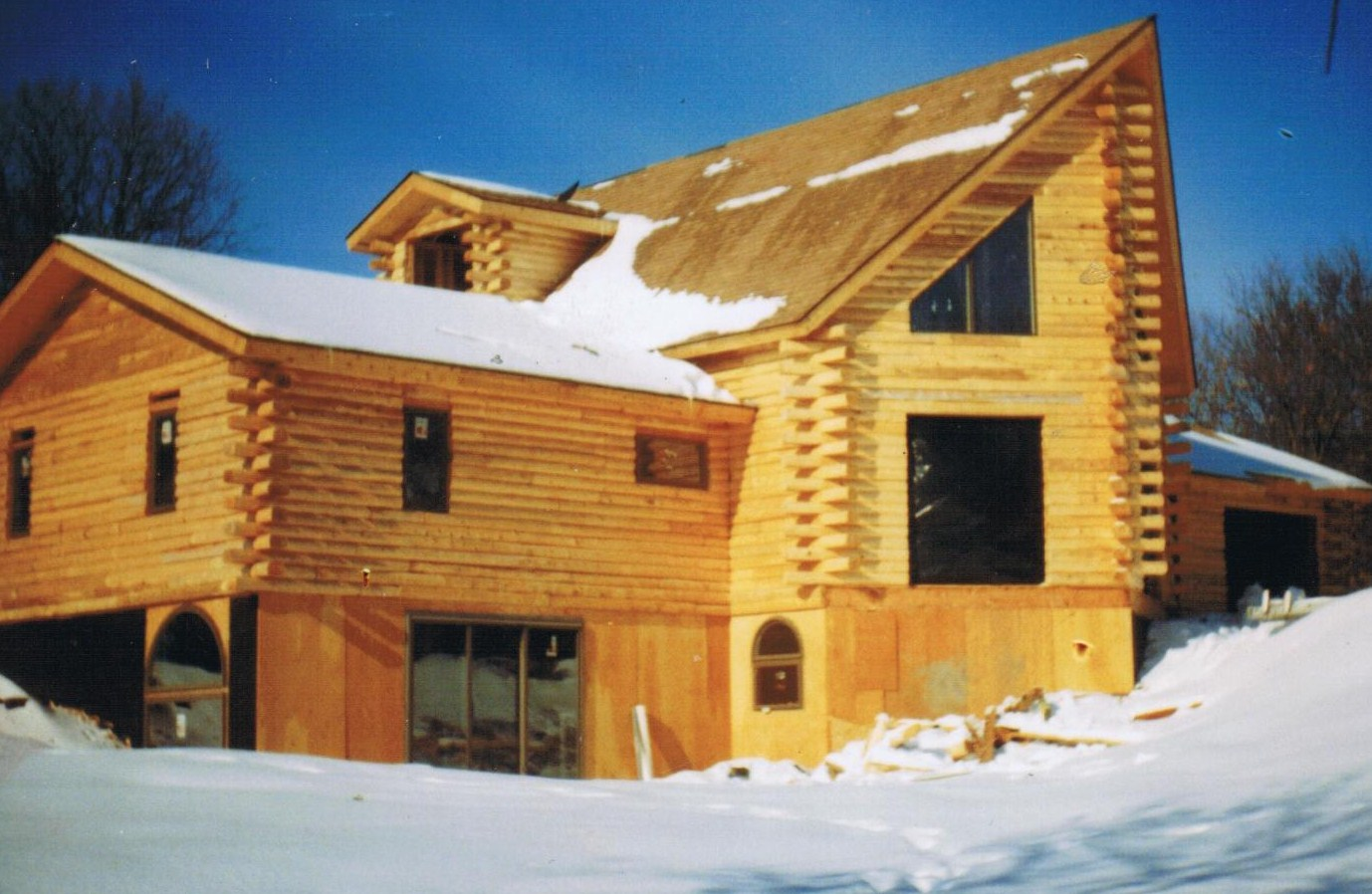 Patriot log home builders what is a hand hewn log home for Prow homes