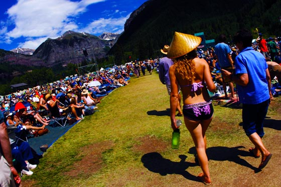 A girl wearing a black and pink bikini at the Telluride Bluegrass Festival.