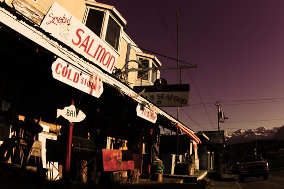 A seafood shop with a big smoked salmon sign in Haines, Alaska on the Alaska Marine Highway.