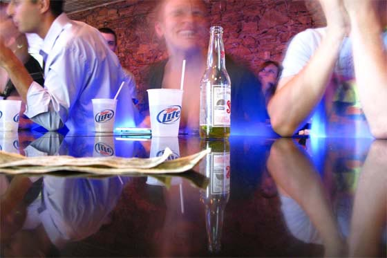 College kids drinking beer at a bar at the University of Kansas in Lawrence, Kansas.