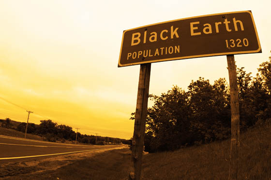 The population sign as you enter Black Earth, Wisconsin.