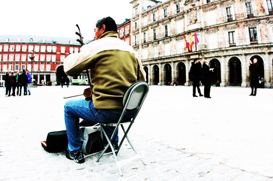 A busker performing in the center of Plaza Mayor in Madrid, Plaza.