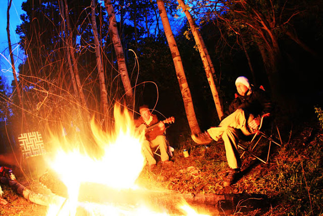 A big campfire during a forest camping session near Mt. Sopris and Aspen, Colorado.