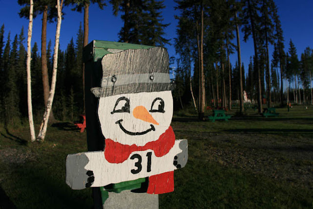 A numbered , snowman, camping marker at the Santaland RV park and campground in North Pole, Alaska.