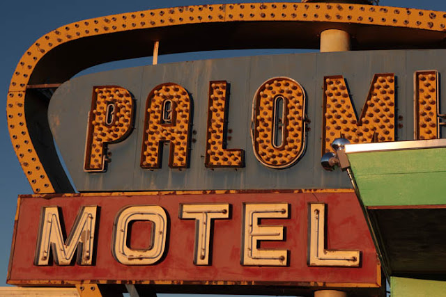 A big, old motel sign during sunrise on Route 66 in Tucumcari, New Mexico.