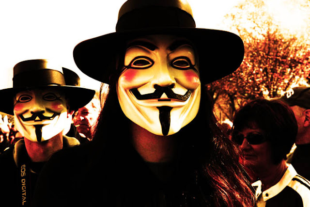 Two Guy Fawkes masks walking around Washington D.C. on Halloween.