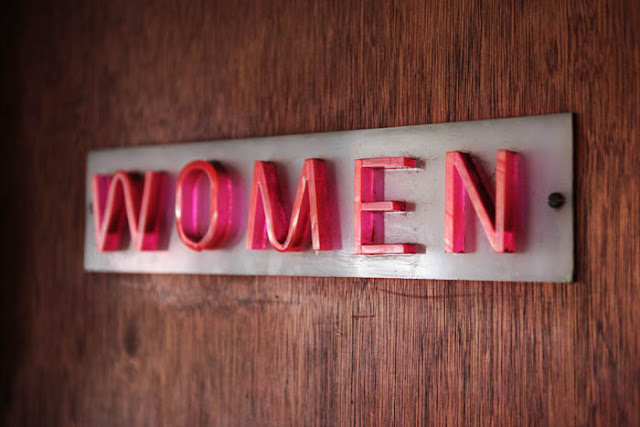A vintage 'Women' sign on a women's room door at a diner in Raton, New Mexico.