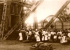 Women and children, at Rhodes' invitation, waiting to be lowered down the De Beers mine shaft to sa