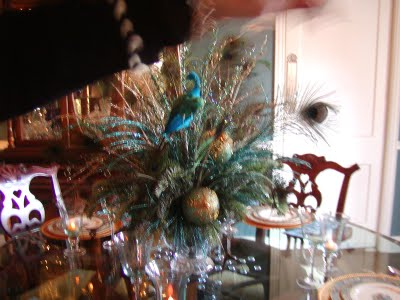 My centerpieces will be peacock feathers with Gold and Taupe shiny balls