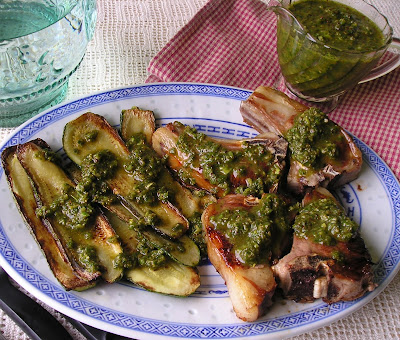 Chimichurri made with garlic scapes on lamb chops and zucchini