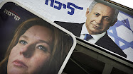 Campaign posters for Likud Party leader Benjamin Netanyahu, top, and his rival,