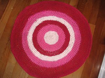 Alfombra en tonos rosa y fucsia