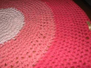 Alfombra tonos rosas