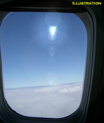 UFO Seen Through Plane Window