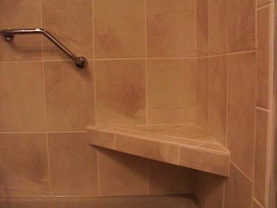 tile shower seat in tan porcelain tile