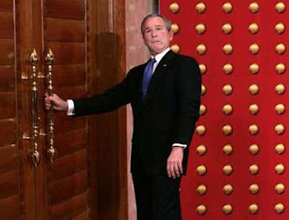 George Bush tries to open A door