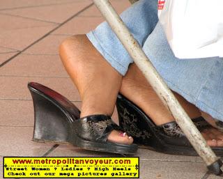 Heeled black wedge sandals