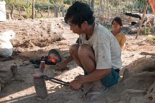 Cambodia - Kachok ethnic making machetes