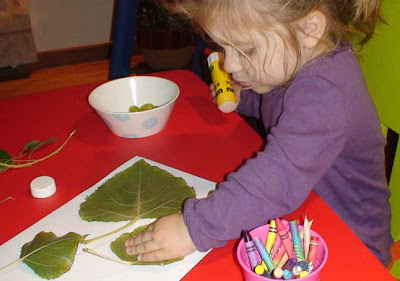 toddler crafts gluing leaves for fall wreath