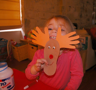 toddler craft hand and foot print cut out Rudolph