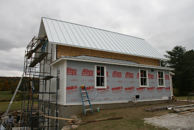 The Silver Standing Seam Metal Roof Is Now On And Scott, Tony, And Nick Are  Beginning To Install The Hardiplank Siding.