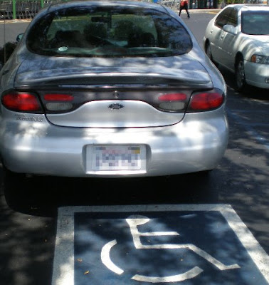 Car in handicap spot, photo by Rosemary West © 2009
