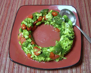 Broccoli and grape tomatoes shaped into a festive wreath by a ring mold